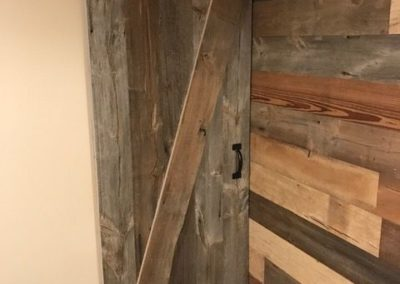 reclaimed custom mix barn siding with wood barn door