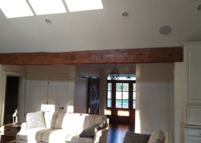 reclaimed hand hewn beam in entry way of house