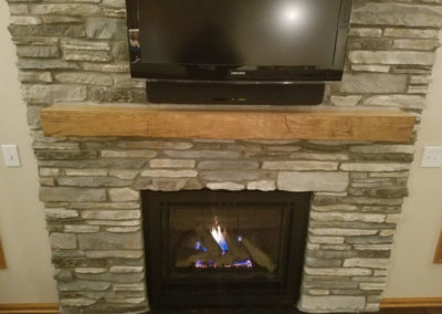 reclaimed hand hewn mantle with smooth top