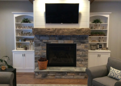 reclaimed hand hewn mantle over fireplace