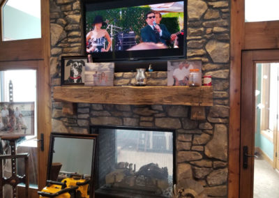 hand hewn mantle with custom corbels