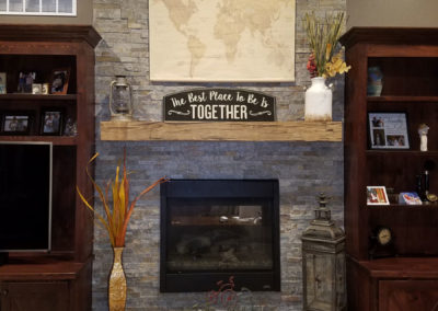 reclaimed smooth hand hewn mantle over fireplace
