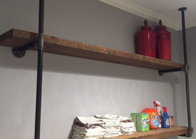 custom reclaimed wood shelves with iron hangers