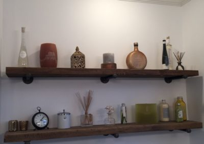 custom reclaimed wood shelves with antique items