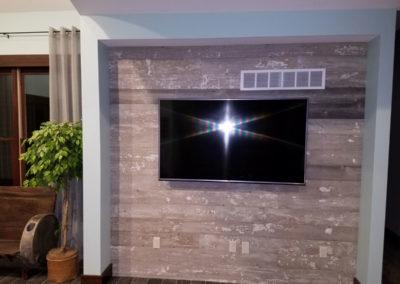 antique reclaimed white barn siding with wall mount TV