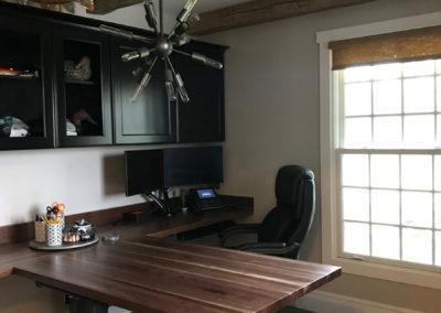 hand hewn ceiling beams with custom reclaimed dark wood table