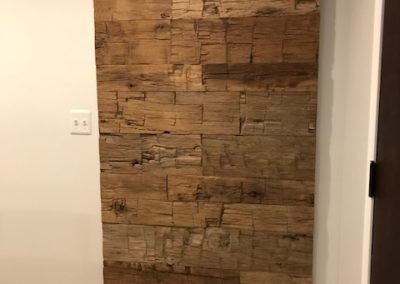 reclaimed barn door made with hand hewn wood skins
