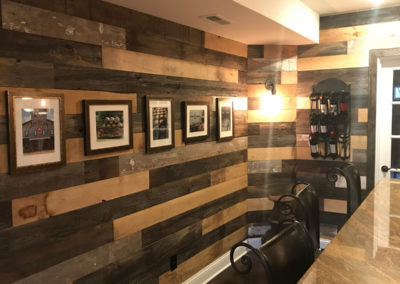 reclaimed mixed hardwood barn siding and paneling in game room