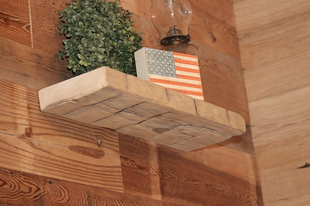 reclaimed hand hewn wood floating shelf with barn siding