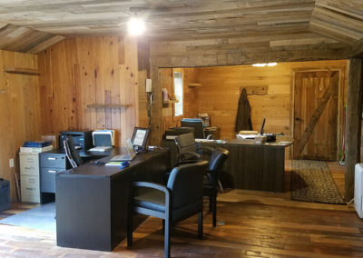 mixed hardwood barn siding on wall in office