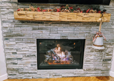 custom hand hewn fireplace mantel